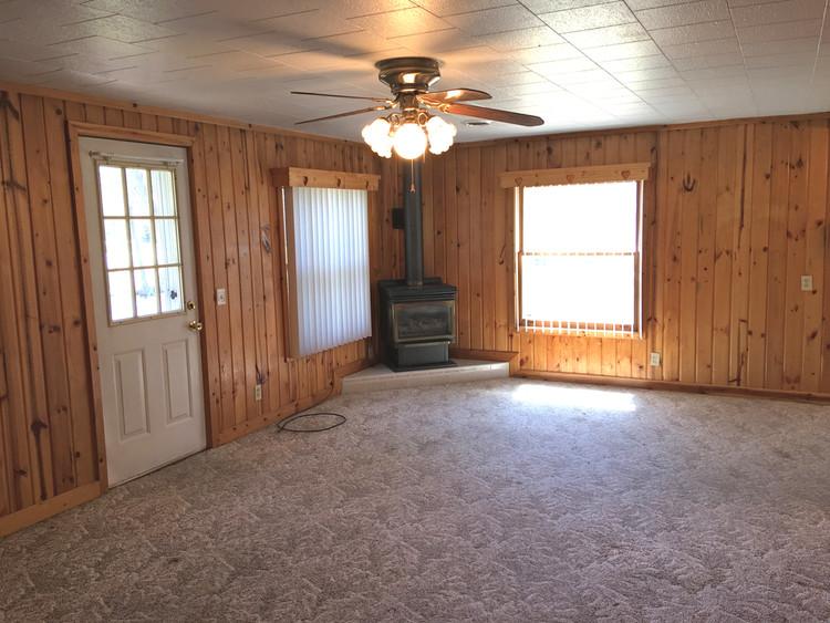 Living Room Fireplace- 781 Orbe Ct, Gladwin